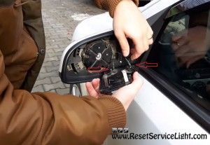 disconnect the wires of the mirro Vauxhall Astra H