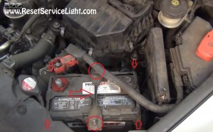 remove the bracket holding and the cover of the battery on Honda Civic
