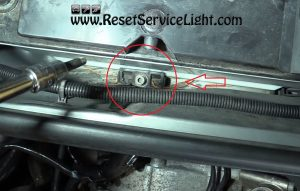 remove the bolt of the battery holding mount on Audi A4 2007