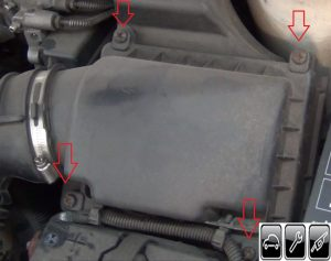 remove the screws holding the cover above the air filter Chevrolet Cavalier