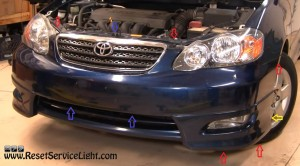 remove the screws of the front bumper on Toyota Corolla