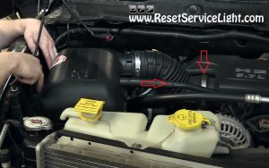 detach the air box and air intake hose on Dodge Ram Hemi
