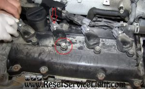 disconnect and remove the ignition coils on Nissan Altima 2003