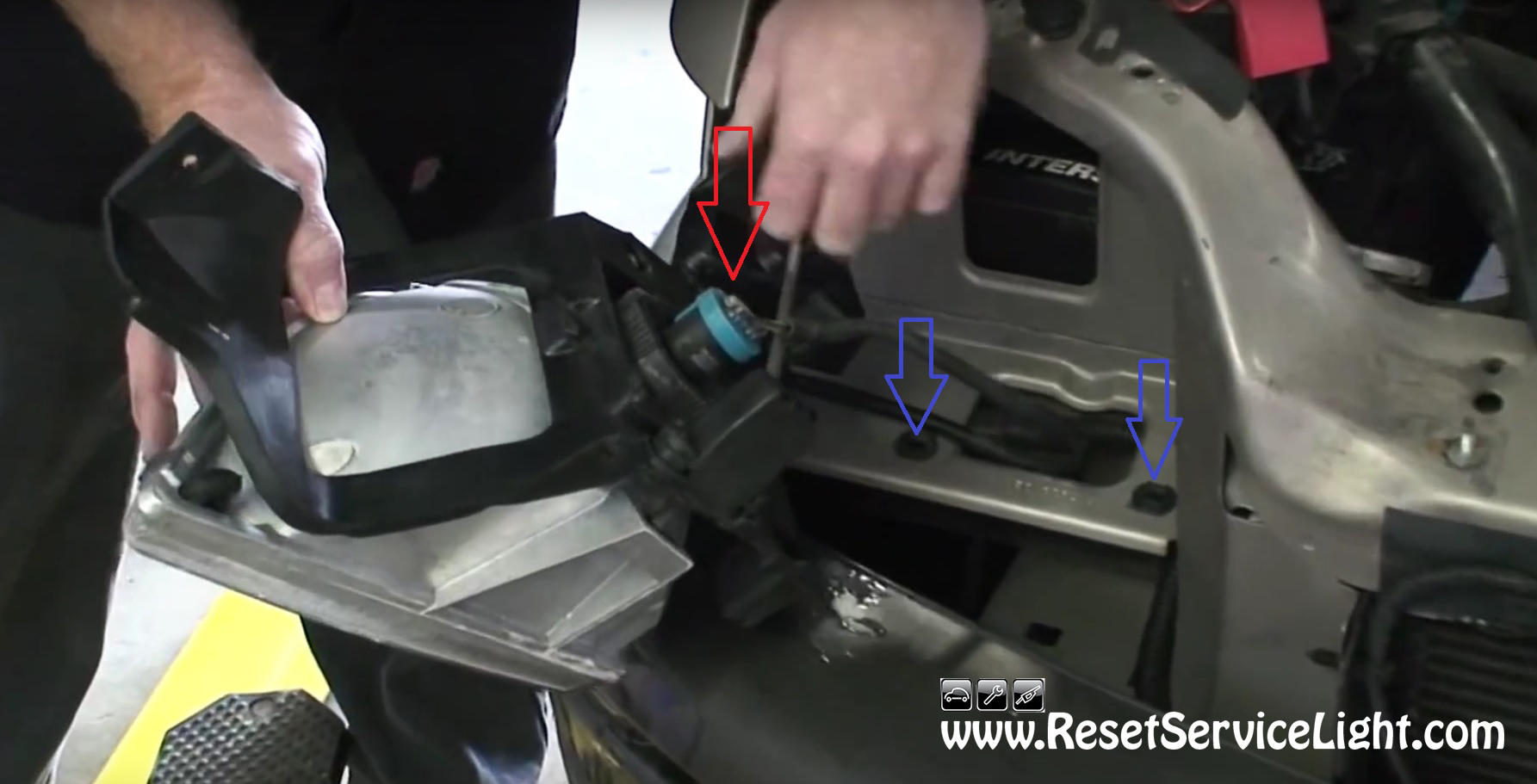 Unplug The Harnesses Of The Headlight On Pontiac Montana
