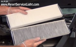 compare old and new air cabin filters on Saturn Vue
