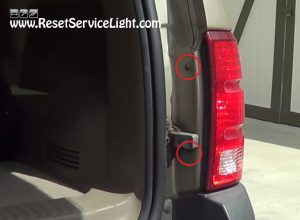 remove the bolts holding the tail light on Ford Explorer