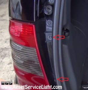 remove the bolts holding the tail light on Mercedes Benz ML 500