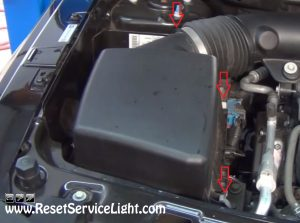 remove the lid of the air box on Saturn Vue 2002-2007