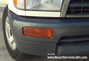 remove the screws holding the turn signal assembly on Toyota 4Runner