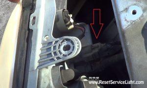 unplug the harnesses of the headlight on Hyundai Santa Fe