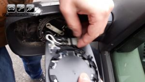 unplug the wires used for heating the glass of the mirror on Renault Megane Mk2