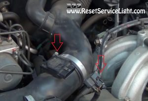 disconnect the air intake hose on Subaru Legacy 2003-2009