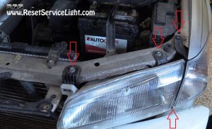 remove the bolts holding the headlight on Toyota Camry 1998