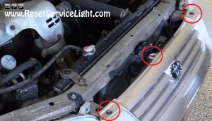 remove the bolts of the bumper on Toyota Camry 1998