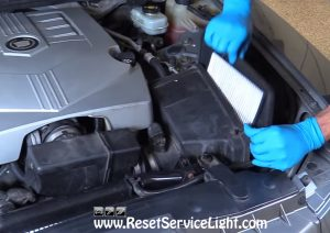 remove the old air filter on Cadillac CTS 2006