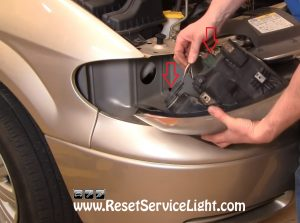unplug the wires of the headlight on Chrysler T&C 2005-2007