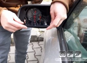 install-the-new-glass-on-the-mirror-of-vauxhall-astra