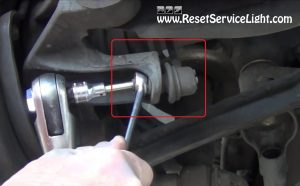 remove-the-nuts-holding-the-sway-bar-on-subaru-legacy-2003-2009