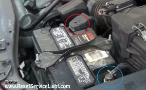 remove-the-terminal-cables-of-the-battery-on-ford-escape