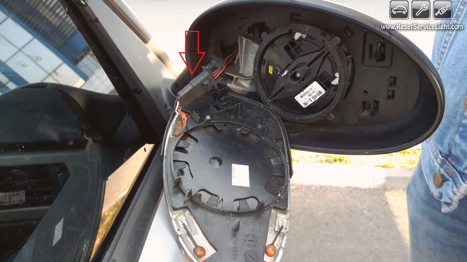 plug-wires-behind-the-gl-of-the-mirror-on-BMW-E90 When To Change Plugs And Wires on when to change brakes, when to change belt, when to change head gaskets, when to change coil, when to change shocks, when to change headers, when to change tires,