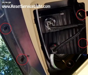 remove the bolts that hold the tail light Honda Odyssey 2005