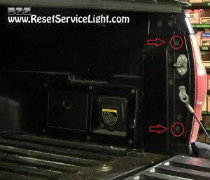 unscrew the bolts of the tail light Toyota Tacoma