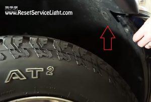 bolt under the wheel holding the head light on Dodge Ram