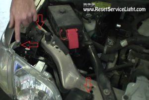 remove the plastic nuts holding the headlight on Pontiac Montana