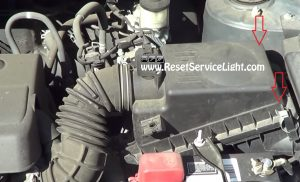 remove the clips holding the air box on Toyota Corolla