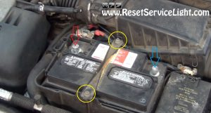 remove the terminals of the battery on Ford Contour