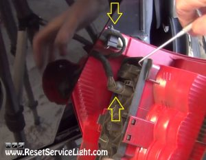 unplug the harnesses of the tail light on Mercedes ML