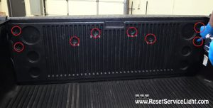 remove the bolts holding the cover of the tailgate on Dodge Ram 2002-2028