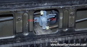 remove the bolts holding the tailgate handle on Dodge Ram