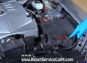remove the screws holding the air box on Cadillac CTS 2006